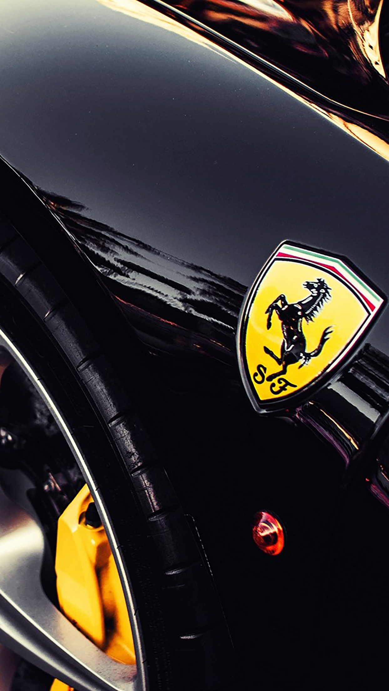 ferrari-logo-and-wheel-3wallpapers-iphone-parallax
