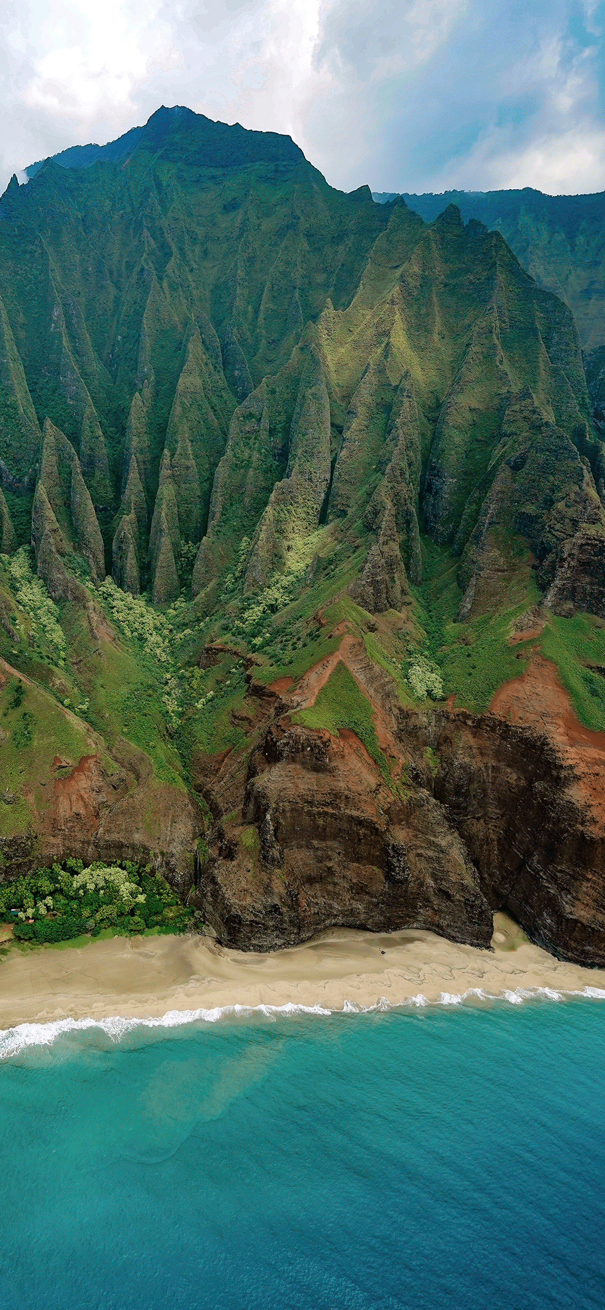 iPhone wallpaper Na%CC%84 Pali Coast mountains Fonds d'écran iPhone du 29/03/2019