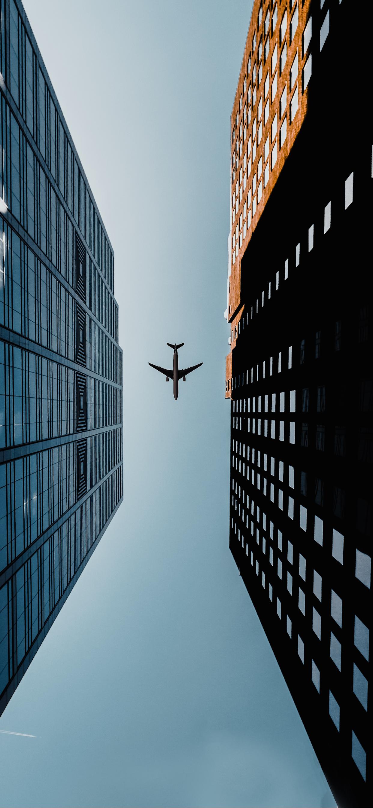 iPhone wallpapers airplane middle buildings Fonds d'écran iPhone du 13/08/2019